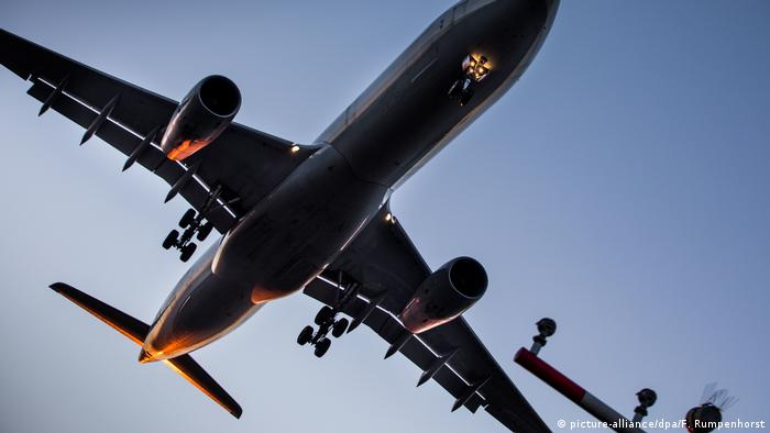 A plane comes in for a landing at Frankfurt Airport