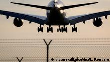 The Airbus A380 widebody civil jet airplane lands behind the airport wired fence while approaching Frankfurt/Main International Airport, Germany (Photo by Leonid Faerberg / Transport-Photo Images) | Verwendung weltweit, Keine Weitergabe an Wiederverkäufer.