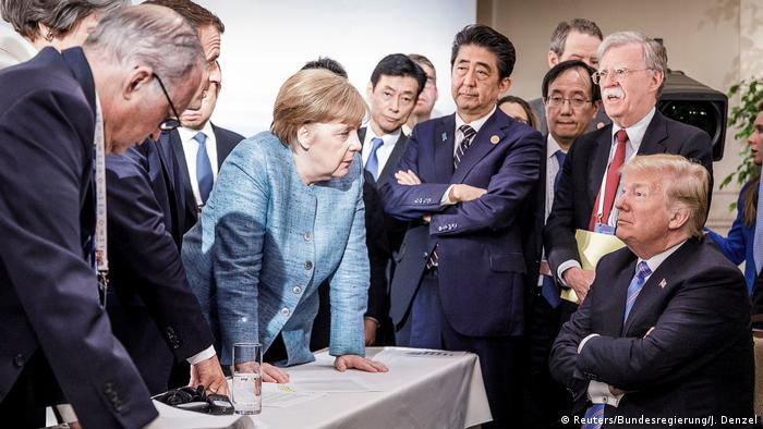 Merkel and Trump surrounded by G7 leaders (Reuters/Bundesregierung/J. Denzel)