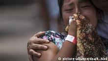 09.06.2018, Guatemala, San Miguel Los Lotes:Damara Toma weint bei der Suche ihrer 6-jährigen Tochter Emily, die seit dem Vulkanausbruch verschwunden ist. Nach dem verheerenden Vulkanausbruch in Guatemala vom 03.06.2018 ist die Zahl der Toten auf mehr als 100 gestiegen. Mehr als 100 werden zudem noch vermisst. Der Katastrophenschutz Conred hatte die Zahl der Vermissten zuletzt am Dienstag mit 192 beziffert. Foto: Rodrigo Abd/AP/dpa +++ dpa-Bildfunk +++  