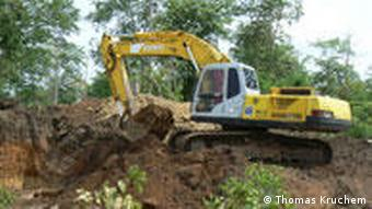 A bulldozer in a forest in Cambodian
