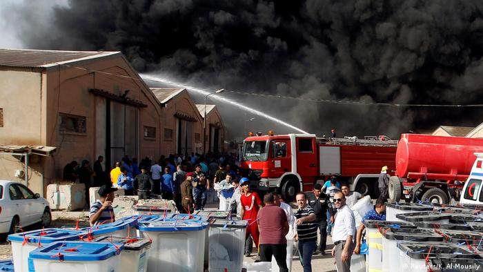 Firefighters at the Baghdad storage center