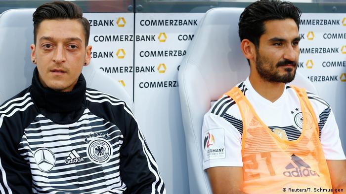 Mesut Özil and Ilkay Gündogan on the bench