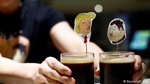A bartender presents a pair of Donald Trump and Kim Jong Un cocktails called The Bromance (Reuters/F. Lim)