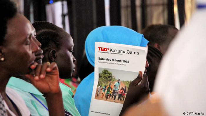 Participants holding the leaflet announcing the TEDx Kakuma Camp conference