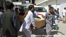 Relatives carry the coffin of a victim after a deadly suicide attack, in Kabul, Afghanistan, Monday, June 11, 2018. Afghan officials said a suicide bomber on foot struck the Rural Rehabilitation and Development Ministry as employees were leaving work in the capital, killing at least 12 people and wounding over 30 days before the start of a holiday cease-fire with the Taliban. (AP Photo/Rahmat Gul) |