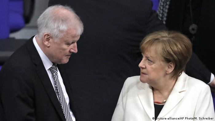 Horst Seehofer and Angela Merkel, pictured after the new government was appointed in Berlin, Germany, Wednesday, March 14, 2018. (picture-alliance/AP Photo/M. Schreiber)