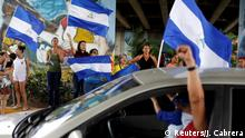 10.06.2018 +++ Demonstrators wave national flags during a protest against Nicaraguan President Daniel Ortega's government, along the street in Managua, Nicaragua June 10, 2018. REUTERS/Jorge Cabrera
