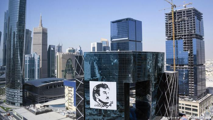 Doha skyline with a huge image of Sheikh Tamim bin Hamad Al Thani on one of the buildings