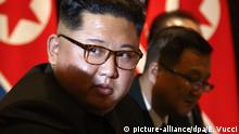 North Korea leader Kim Jong Un looks at the news media during a photo session during a expanded bilateral meeting with U.S. President Donald Trump at the Capella resort on Sentosa Island Tuesday, June 12, 2018 in Singapore. (AP Photo/Evan Vucci) |