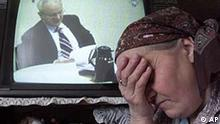 Bosnian Muslim woman Fatima Begovic, 53, cries as she watches former Yugoslavian President Slobodan Milosevic on television during his trial at the UN war crimes tribunal in The Hague, Thursday, Feb. 14, 2002 in refugee center for Srebrenica widows in Tuzla. All of the male members of her family are missing since the Srebrenica massacre. Milosevic is accused of war crimes committed against non-Serbs in Kosovo, Croatia and Bosnia, including the Srebrenica massacre. (AP Photo/Amel Emric)