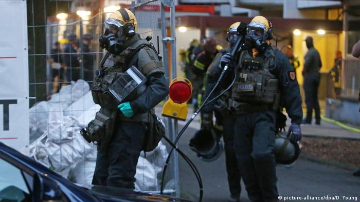 German elite SEK police commandos at the scene of the 18-story apartment block in Cologne from where a Tunisian man was arrested.