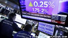 A television screen on the floor of the New York Stock Exchange shows the rate decision of the Federal Reserve on Wednesday, June 13, 2018. The Federal Reserve has raised its benchmark interest rate for the second time this year on Wednesday and signaled that it may step up its pace of rate increases because of solid economic growth and rising inflation. (AP Photo/Richard Drew) |
