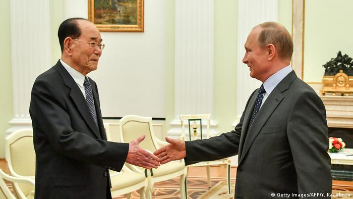 Russian President Vladimir Putin (R) with President of the North Korean Presidium of the Supreme People's Assembly Kim Yong-nam