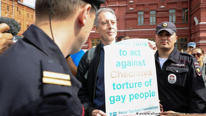 British gay rights activist Peter Tatchell arrested in Moscow while holding a poster critical of President Vladimir Putin