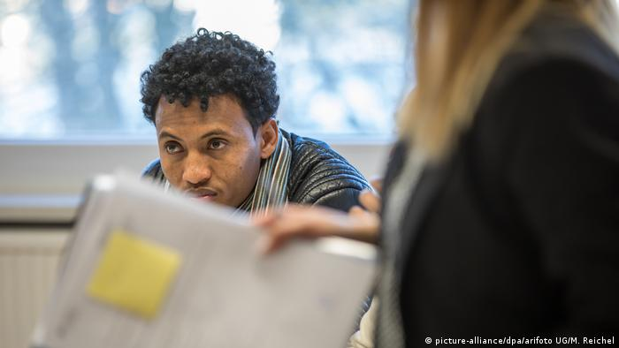 An Eritrean refugee waits to be processed in Germany