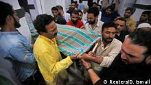 14.06.2018+++ People carry the body of Syed Shujaat Bukhari, the editor of Rising Kashmir daily newspaper, who was killed by unidentified gunmen outside his office in Srinagar, June 14, 2018. REUTERS/Danish Ismail