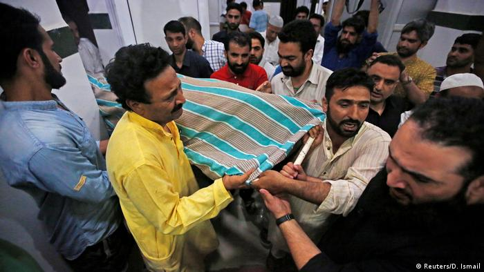 People carry the body of Indian journalist Shujaat Bukhari dead