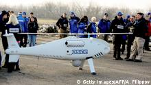 28.03.2018 *** Members of the Organization for Security and Co-operation in Europe (OSCE) Observer Mission, Special Monitoring Mission in Ukraine, arrive for the test flight of the unmanned aerial vehicle Camcopter S-100? along the eastern front line near Ukraine's village of Stepanivka in the Donetsk region, about thirty kilometers from the front line between pro-Russian separatists and the Ukrainian army on March 28, 2018. / AFP PHOTO / Aleksey FILIPPOV (Photo credit should read ALEKSEY FILIPPOV/AFP/Getty Images)