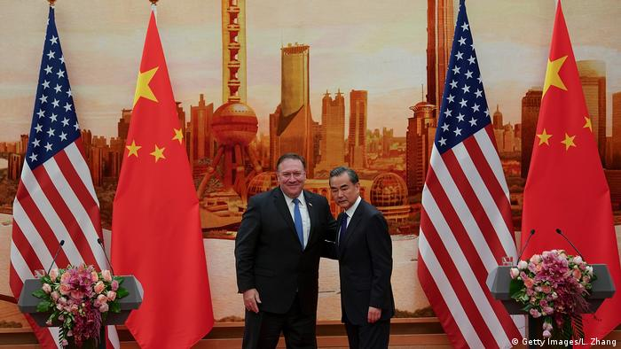 Chinese Foreign Minister Wang Yi (R) shakes hands with U.S. Secretary of State Mike Pompeo (L) during a press conference