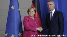 15.6.2018, Berlin German Chancellor Angela Merkel, left, and NATO Secretary General Jens Stoltenberg, right, shake hands after a meeting at the chancellery in Berlin, Friday, June 15, 2018. (AP Photo/Markus Schreiber) |