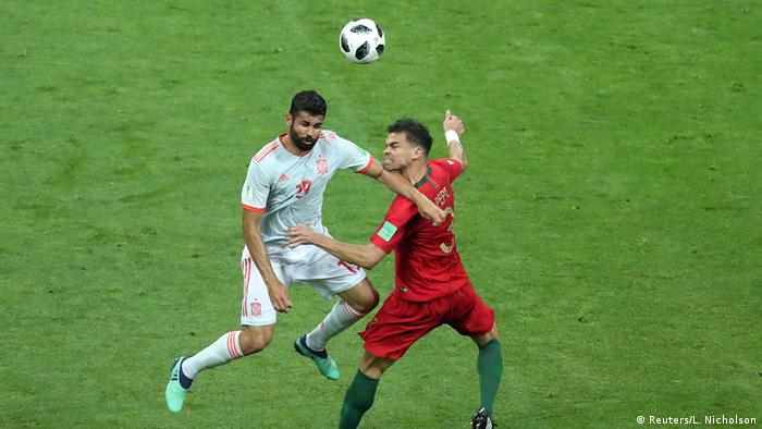 Diego Costa and Pepe in the challenge that led to Spain's first goal (Reuters/L. Nicholson)