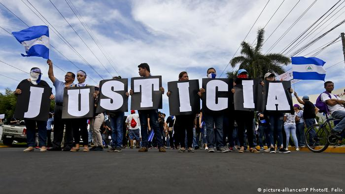 Protesters demand justice at a rally against President Daniel Ortega