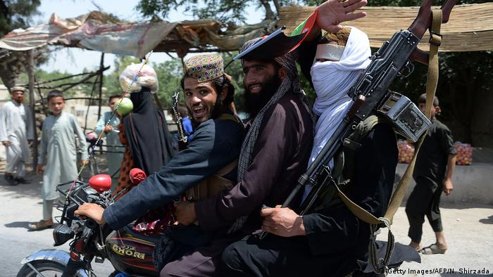 Taliban fighters celebrating a truce on the second day of Eid