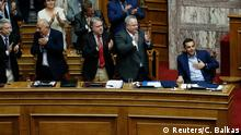 16.6.2018*** Greek Prime Minister Alexis Tsipras is applauded by lawmakers after his speech during a parliamentary session before a vote following a motion of no confidence by the main opposition in dispute over a deal on neighbouring Macedonia's name, in Athens, Greece June 16, 2018. REUTERS/Costas Baltas