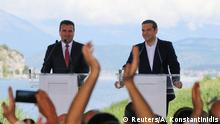 Greek Prime Minister Alexis Tsipras and Macedonian Prime Minister Zoran Zaev speak before the signing of an accord to settle a long dispute over the former Yugoslav republic's name in the village of Psarades, in Prespes, Greece, June 17, 2018. REUTERS/Alkis Konstantinidis