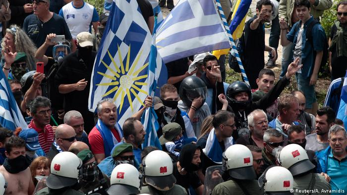 Protesters argue with riot police during a demonstration against the agreement reached by Greece and Macedonia to resolve a dispute over the former Yugoslav republic's name