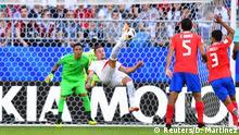 Soccer Football - World Cup - Group E - Costa Rica vs Serbia - Samara Arena, Samara, Russia - June 17, 2018 Serbia's Sergej Milinkovic-Savic attempts an overhead kick REUTERS/Dylan Martinez