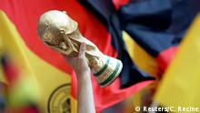Soccer Football - World Cup - Group F - Germany vs Mexico - Luzhniki Stadium, Moscow, Russia - June 17, 2018 Fan holds up a replica World Cup trophy inside the stadium before the match REUTERS/Carl Recine
