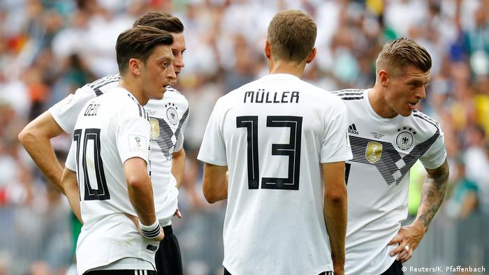 Germany's Mesut Ozil, Julian Draxler, Thomas Muller and Toni Kroos look dejected after Mexico's Hirving Lozano (not pictured) scored their first goal