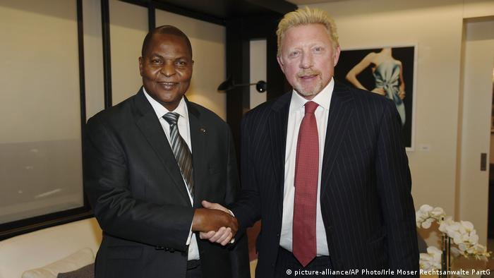 In this file photo originally released on Friday, April 27, 2018, President Prof. Faustin Archange Touadera, left, shakes hands with retired German tennis star Boris Becker in Brussels, Belgium, after it was announced Becker has been appointed by the Central African Republic as its Attache for Sports and Humanitarian and Cultural Affairs in the European Union with immediate effect. (Photo: Irle Moser Rechtsanwalte PartG via AP Images, FILE)