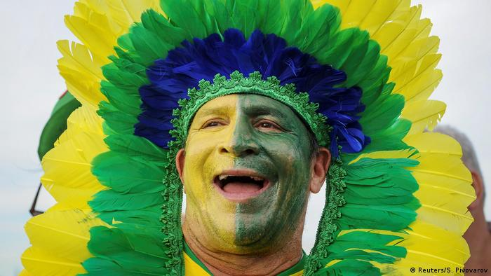 A supporter of Brazil national soccer team reacts during a welcoming ceremony on a Fan Fest.