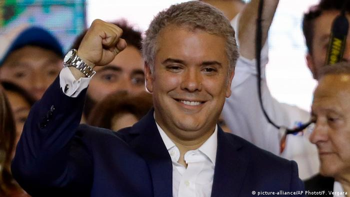 Colombia's President Elect Ivan Duque celebrates his victory in the presidential runoff election