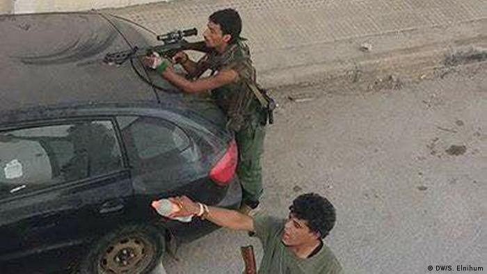 Two fighters in the Libyan town of Derna