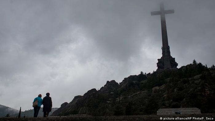 Tourists walk outside the Valle de los Caidos (Valley of the Fallen