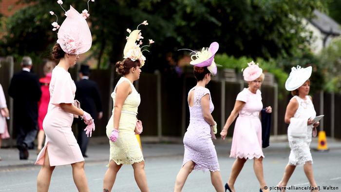 women wearing pastel dresses and big hats