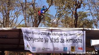 A banner marking World Refugee Day