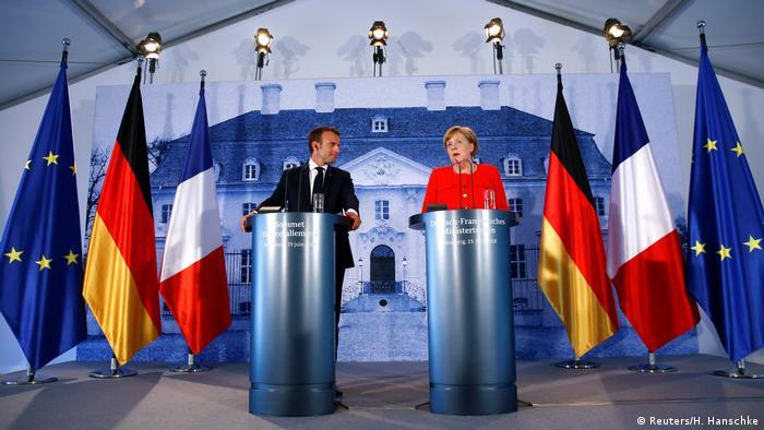 Fransa Cumhurbaşkanı Macron (solda) ve Almanya Başbakanı Merkel