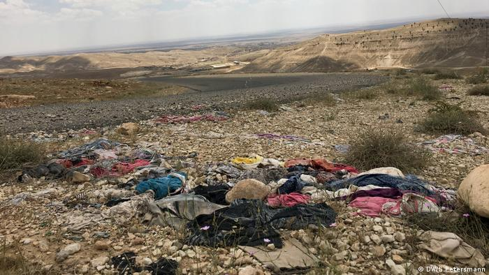 Torn clothes along the roadside can still be found on Mount Sinjar