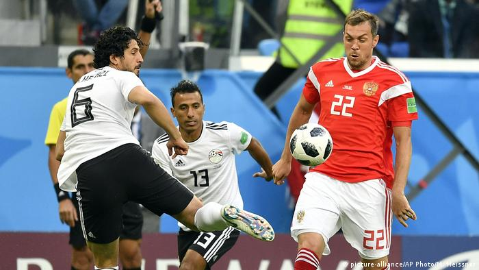 Egypt's Ahmed Hegazy, left, and Russia's Artyom Dzyuba, right, challenge for the ball during the group A match between Russia and Egypt at the 2018 soccer World Cup in the St. Petersburg stadium in St. Petersburg, Russia, Tuesday, June 19, 2018.