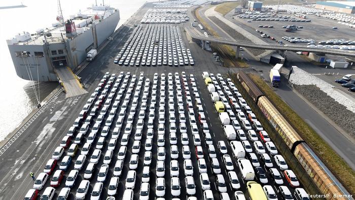 Volkswagen being loaded onto freighter for exporter