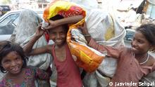 Child waste-pickers holding a sack (Jasvinder Sehgal)