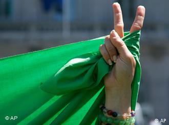 A woman shows the victory sign during a protest in Brussels, Wednesday, June 24, 2009.