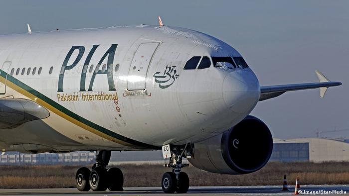 A Pakistan International Airlines plane on a tarmac