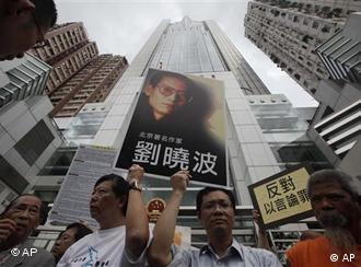 Pro-democracy lawmakers and activists in Hong Kong demand the release of Liu Xiaobo