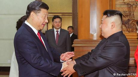 Chinese President Xi Jinping shakes hands with North Korean leader Kim Jong Un in Beijing (Reuters/KCNA)